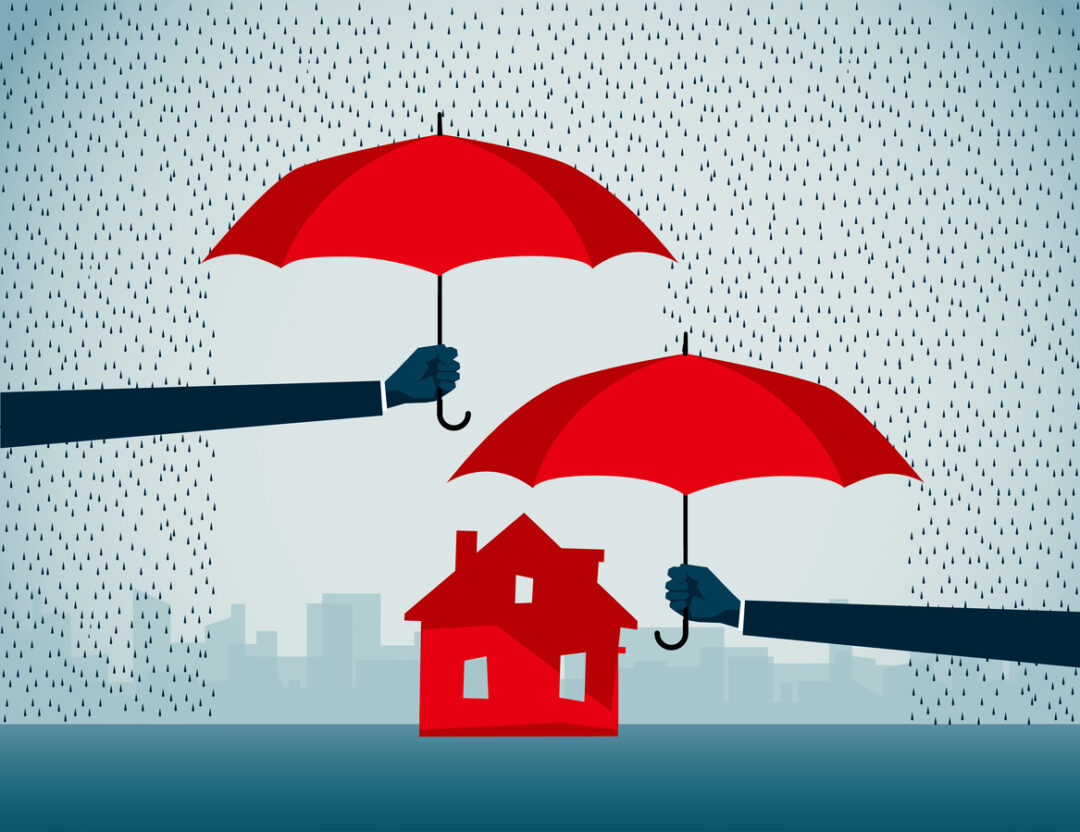 Home insurance - 2 umbrellas protecting a red house