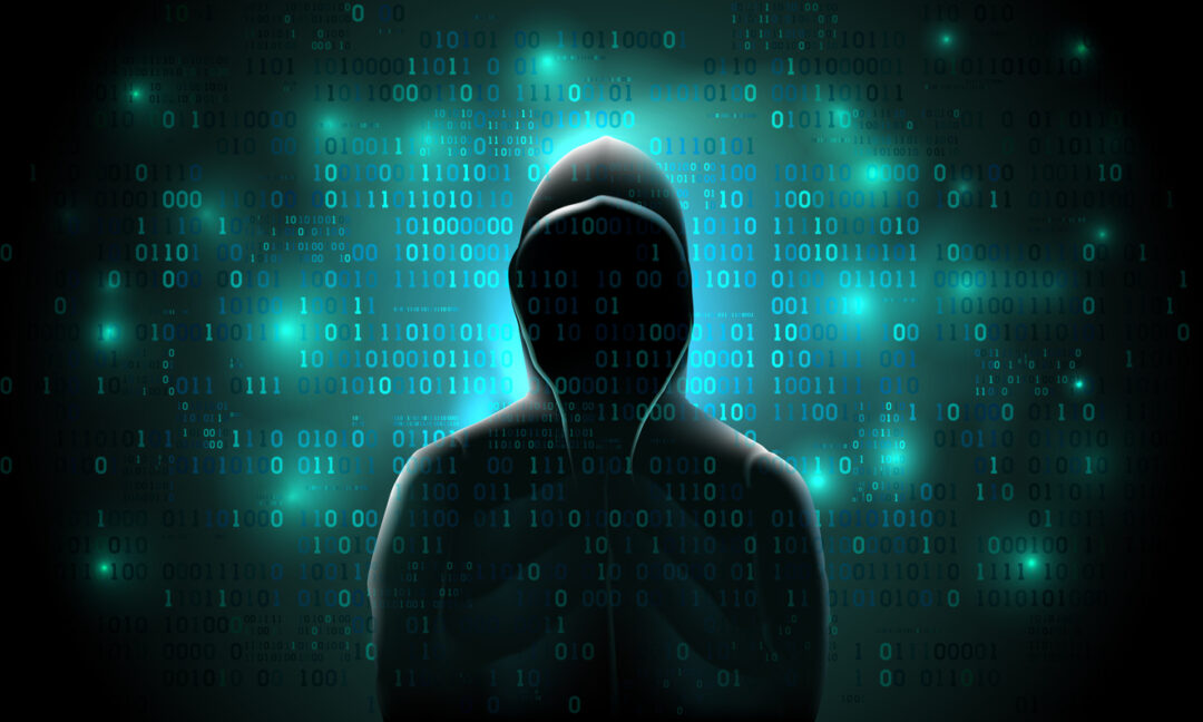 hooded-hacker-executing-cyber-attack-binary-code-overlay