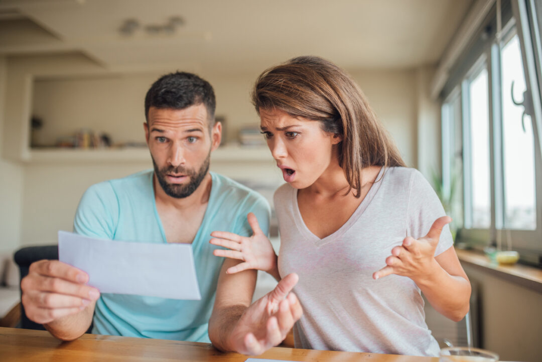 young-couple-shocked-at-their-new-homeowners-insurance-policy