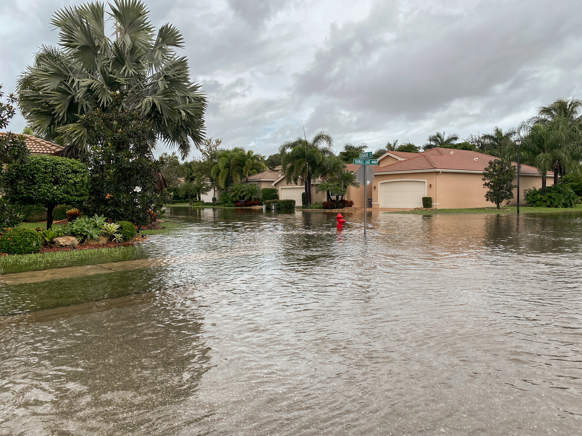 A suburban neighborhood is flooded from a hurricane and the homeowners aren't covered by standard hurricane insurance